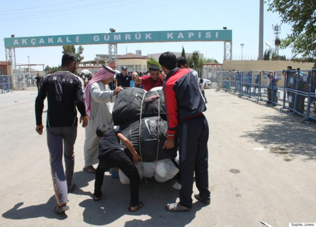 Syrians gather their belongings to return to Syria on June 17 after fleeing clashes between ISIS and Kurdish forces, backed by the FSA and US strikes, earlier in the week.