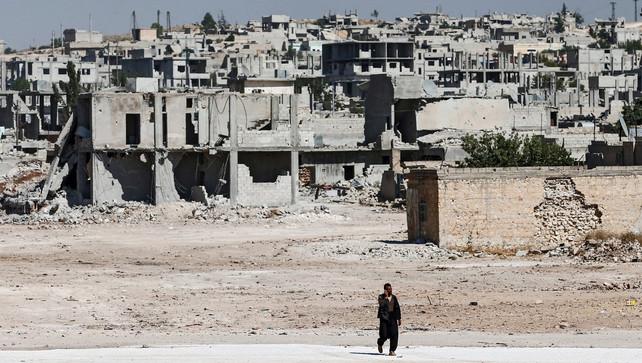 Vluchtelingen waren nog maar pas beginnen terugkeren naar het door bij vorige gevechten zwaar toegetakelde Kobane. ©EPA