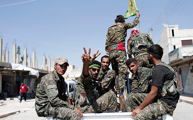 Members of Kurdish People Defence Units (YPG) flash victory signs after returning from Raqqa Photo: EPA/SEDAT SUNA