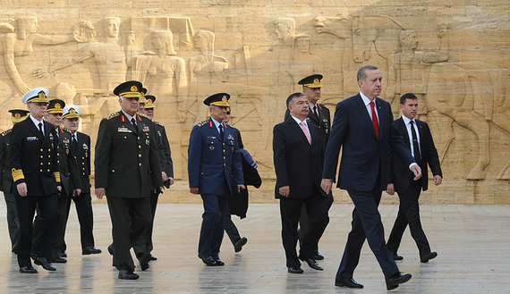 Turkey's Prime Minister Tayyip Erdogan (R) leaves after a wreath-laying ceremony with members of the Supreme Military Council at the mausoleum of Mustafa Kemal Ataturk, the founder of modern Turkey, in Ankara November 30, 2012. Erdogan will chair the twice-yearly meeting of the Supreme Military Council at army headquarters. REUTERS/Stringer (TURKEY - Tags: POLITICS MILITARY) - RTR3B1R8