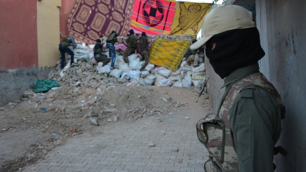 Armed Kurds man a checkpoint in Cizre, southeastern Turkey