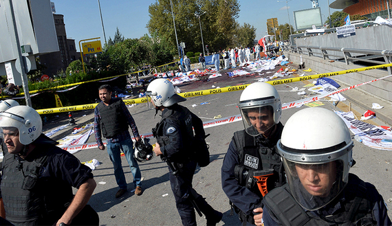Police forensic experts examine the scene following explosions during a peace march in Ankara, Oct. 10, 2015. (photo by REUTERS/Stringer)