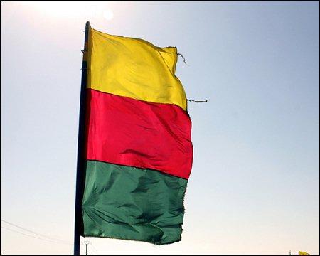 Syrian-Kurdistan-flag-photo-Rozh-Ahmad-monthlyreview-org