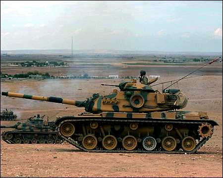 Turkish tanks on Syria border. Photo: AP