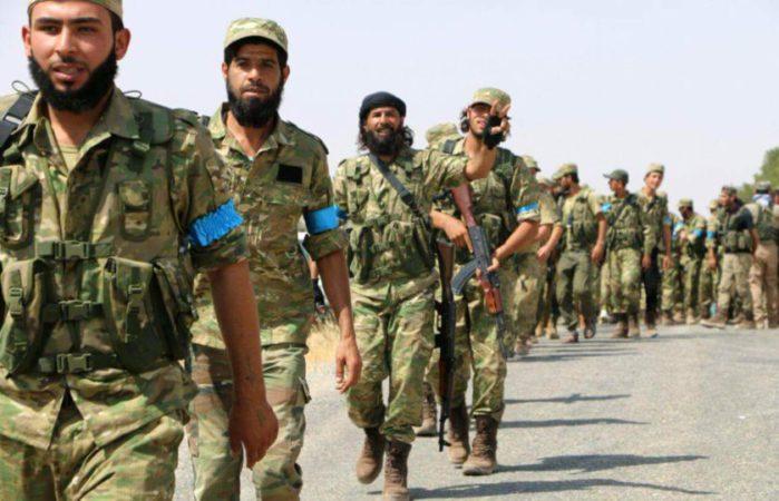 CqnaVMCWcAUccFS.jpg Rebel fighters of the Turkey-backed Sultan Murad Brigade entering Jarablus. File photo ARA News